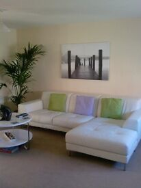 White leather settee with chase end