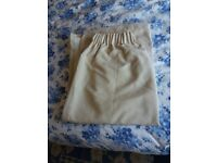 Pair cream coloured curtains