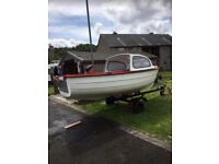 I4ft Mayland boat good trailer and a 5horse power Yamaha engine ready for the water