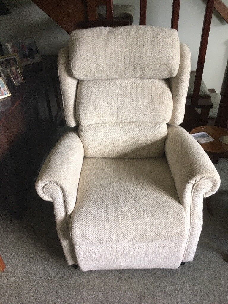 Reclining and forward tipping electric beige quality armchair.