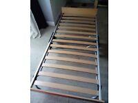 Metal framed foldaway bed.