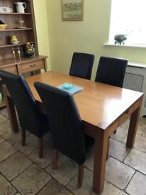 Oak table 4 leather chairs. Matching dresser in separate ad. Available in approx 10 days.