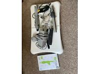 Nintendo Wii with Balance Board, Controller, Nunchucks and Wii Fit