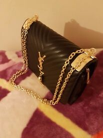 Brand new ladies ysl clutch/handbag Leather goldchain