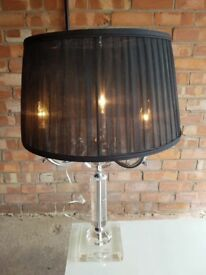 Table lamp with black pleated shade