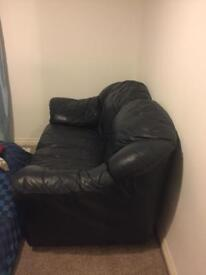 Leather two seater sofa in blue