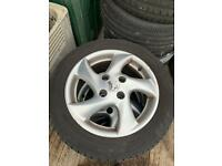 15 inch 4 stud Peugeot alloy wheels with good tyres