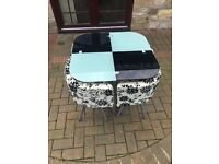 glass space saving table and chairs