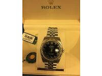 Brand New Mens Rolex Watch 116234 black roman dial white gold bezel unworn with box and papers.