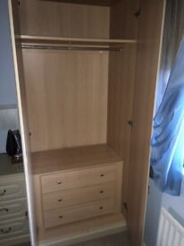 Wardrobe with internal chest of drawers and bedside unit