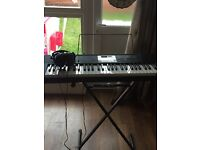 Casio electric keyboard with stand & set of Phillips headphones