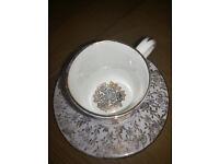 Miniature teacup and saucer