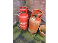 Two gas 19kg propane bottles for sale/ scrape metal, one regulator attached