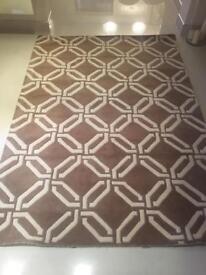 Modern beige and ivory designer rug