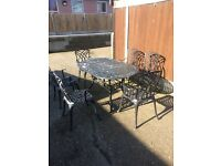 Cast aluminium table and 6 chairs