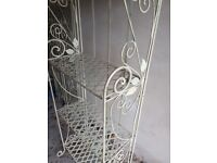 Two large decorative metal shelving stands