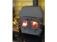 Villager Wood & Solid Fuel Stove with black flue pipe. In good condition.