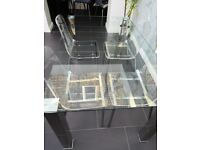 Glass dining table and 4 x clear acrylic chairs
