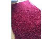 Red large rug 8 ft long by 5ft good condition