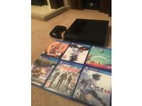 PS4 Playstation 4 System (500gb) with 8 games.