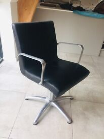Salon chairs. Height adjustable. Black leather and stainless steel.