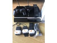 Sony ps3 with 60 top games, eye, arm fitness band, remote ect