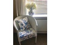 White rattan tub chair with cushion