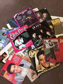 Roughly 100 different records ranging from Elvis Presley to Madonna in great condition.