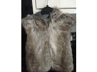 Fur Gilet by Next - for child age 10years old- as new - bargain £10
