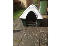 Plastic dog kennel in good condition
