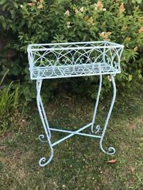 Light blue decorative metal plant stand with matching items available