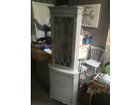 Antique shabby chic corner cupboard in French grey.