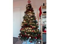 7ft Canadian fir tree. Decorations included. One year old. Original price £80.