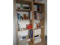 Two tall oak veneer shelf units
