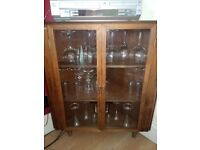 REDUCED PRICE Handy corner cupboard with glass doors. £20