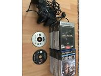 22 ps2 games and 2 controllers
