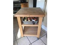 Butchers block with wheels in good condition.