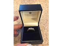 Stunning yellow gold and white gold cubic zirconia three stone ring