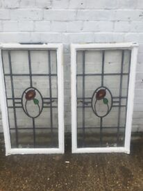 A pair of crittall windows with coloured leaded glass
