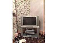 Old toshiba TV with stand and digibox. LG vhs video recorder. And toshiba DVD player.