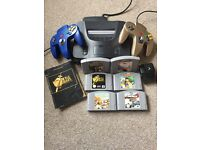 Nintendo 64 console with 2 controllers including limited edition gold controller and 6 games