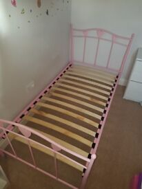 Girls single pink metal frame bed with hearts from Next