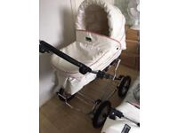 Pink and white leather baby style pram