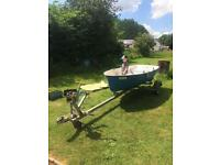 Boat trailer and fibre glass rowing boat