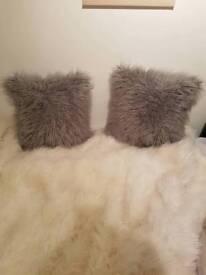 2 Mongolian fur cushions light grey