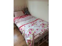 Pink stainless steel bed with mattress