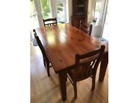 Large solid wood dining table and 6 chairs