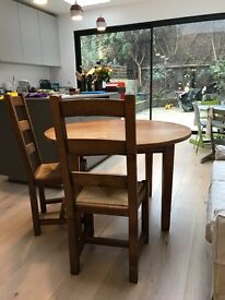 Solid wooden table and 4 dining chairs for sale