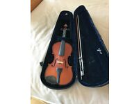 Violin in backpack type carry case it's a 3/4 size in great condition