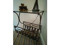 Glass top brown coloured table, magazine rack